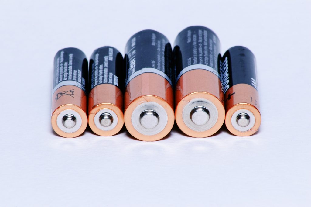 five different sized batteries in a horizontal line
